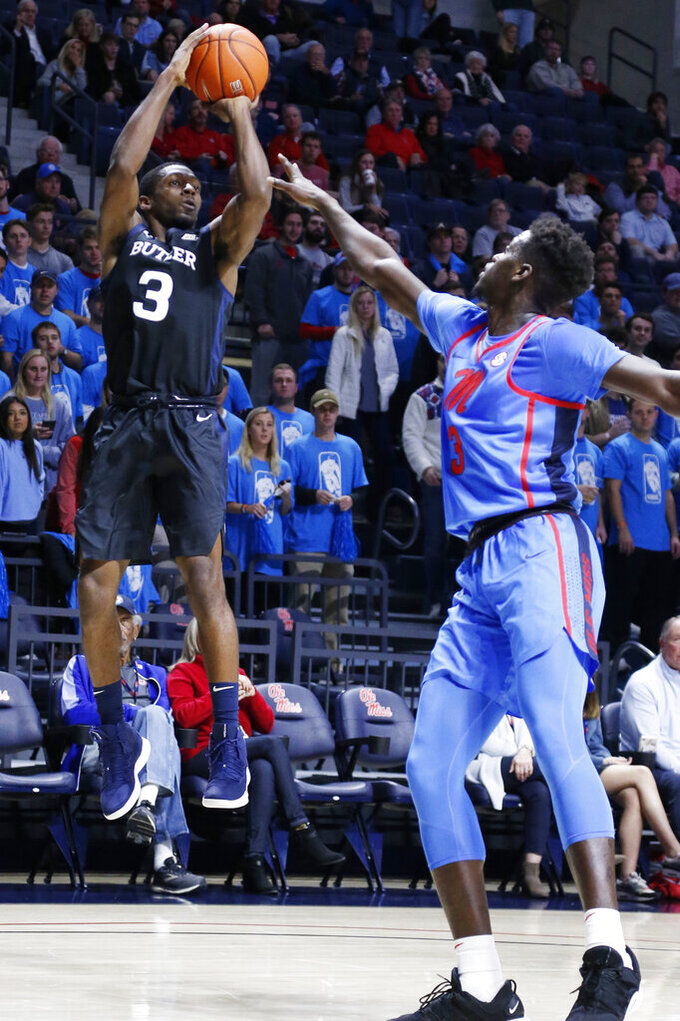 Butler guard Kamar Baldwin shoots next to Mississippi forward Khadim Sy during the first half of an NCAA college basketball game in Oxford, Miss., Tuesday, Dec. 3, 2019. (AP Photo/Rogelio V. Solis)