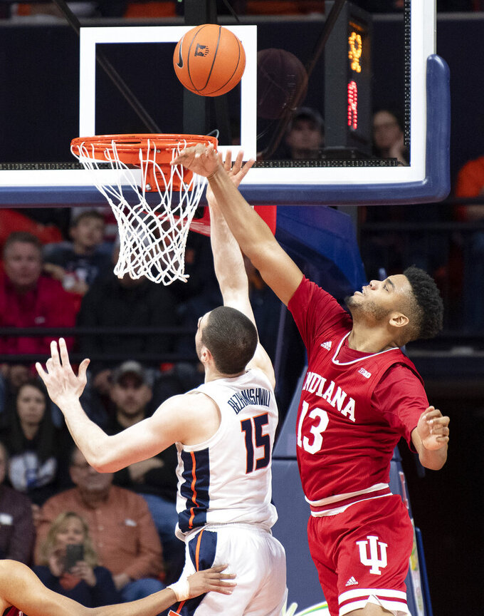 Indiana forward Juwan Morgan (13) defends against a shot from Illinois forward Giorgi Bezhanishvili (15) during the second half of an NCAA college basketball game in Champaign, Ill., Thursday, March 7, 2019. (AP Photo/Stephen Haas)