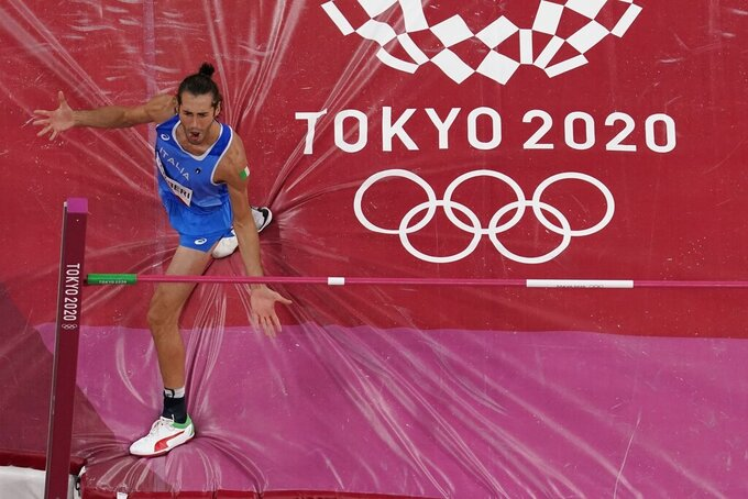 Gianmarco Tamberi, of Italy, competes during the finals of the men's high jump at the 2020 Summer Olympics, Sunday, Aug. 1, 2021, in Tokyo. (AP Photo/Morry Gash)