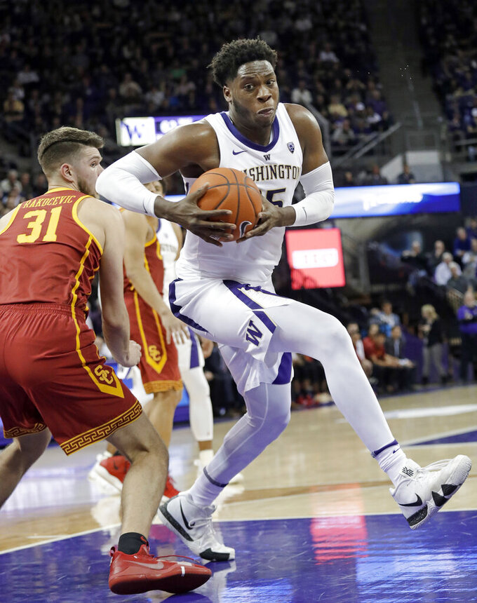 Washington's Noah Dickerson, right, turns past Southern California's Nick Rakocevic to shoot during the second half of an NCAA college basketball game Wednesday, Jan. 30, 2019, in Seattle. Washington won 75-62. (AP Photo/Elaine Thompson)