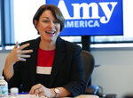 FILE - In this Tuesday, April 16, 2019 file photo, Democratic presidential candidate Amy Klobuchar speaks during a roundtable discussion on health care, in Miami. Former President Jimmy Carter has never been known as a key player in Democratic Party politics, but he's re-emerging in the 2020 is presidential race as some candidates go to Plains, Ga., to seek the 94-year-old's advice. Minnesota Sen. Klobuchar says Carter's 1976 campaign after the Watergate scandal drove Richard Nixon from the Oval Office is relevant as Democrats take on President Donald Trump. (AP Photo/Wilfredo Lee, File)