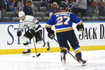 Los Angeles Kings' Dustin Brown, left, drives the puck down ice as St. Louis Blues' Alex Pietrangelo (27) closes in to defend during the second period of an NHL hockey game Thursday Oct. 24, 2019, in St. Louis. (AP Photo/Scott Kane)