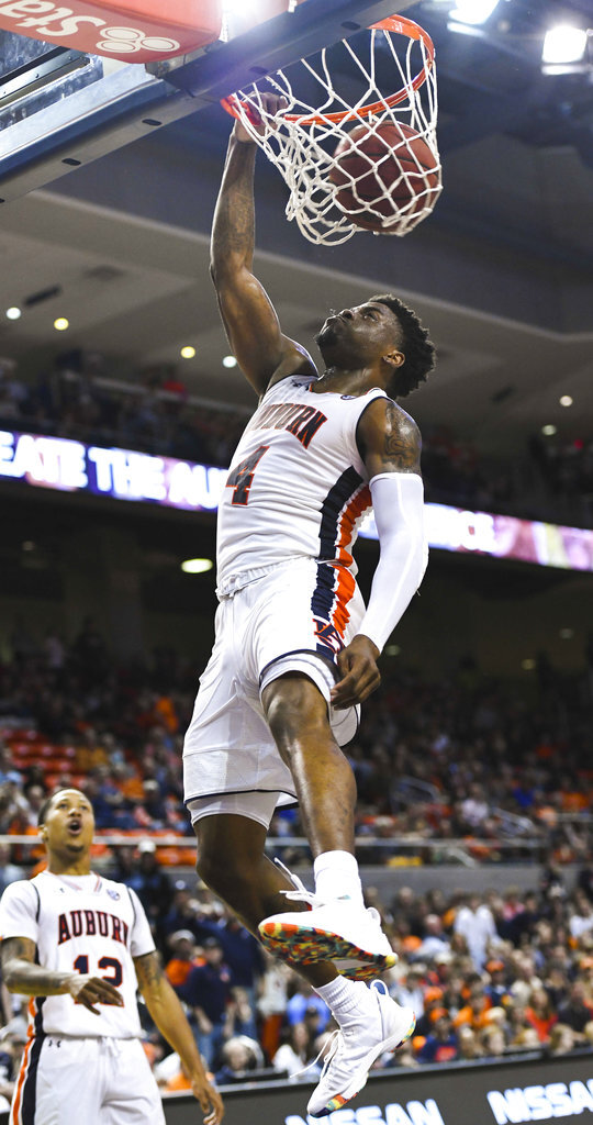 Auburn player Malik Dunbar (4) dunks for two against North Florida during the second half of an NCAA college basketball game Saturday, Dec. 29, 2018, in Auburn, Ala. (AP Photo/Julie Bennett)