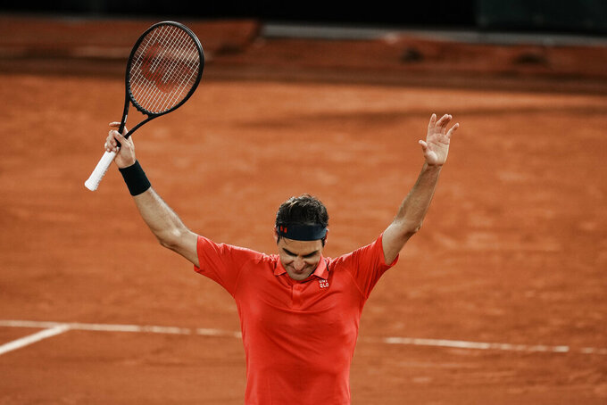 Switzerland's Roger Federer celebrates after defeating Germany's Dominik Koepfer in their third round match on day 7, of the French Open tennis tournament at Roland Garros in Paris, France, Saturday, June 5, 2021. (AP Photo/Thibault Camus)