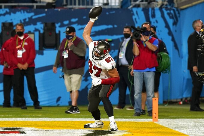 Tampa Bay Buccaneers tight end Rob Gronkowski celebrates after catching an 8-yard touchdown pass during the first half of the NFL Super Bowl 55 football game against the Kansas City Chiefs Sunday, Feb. 7, 2021, in Tampa, Fla. (AP Photo/Lynne Sladky)