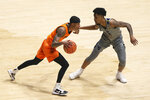 Oklahoma State guard Avery Anderson III (0) is defended by West Virginia guard Taz Sherman (12) during the first half of an NCAA college basketball game Saturday, March 6, 2021, in Morgantown, W.Va. (AP Photo/Kathleen Batten)