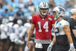 Carolina Panthers quarterback Sam Darnold, left, talks to running back Christian McCaffreyduring Fan Fest practice at the NFL football team's training camp in Charlotte, N.C., Friday, Aug. 6, 2021. (AP Photo/Nell Redmond)