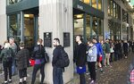A long line of people wanting to vote forms outside the Multnomah County elections office by mid-afternoon Tuesday, Nov. 6, 2018, in Portland, Ore.  (Betsy Hammond/The Oregonian via AP)