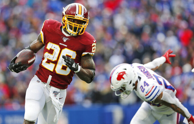 Washington Redskins running back Adrian Peterson (26) rushes against Buffalo Bills cornerback Taron Johnson (24) during the first half of an NFL football game, Sunday, Nov. 3, 2019, in Orchard Park, N.Y. (AP Photo/John Munson)