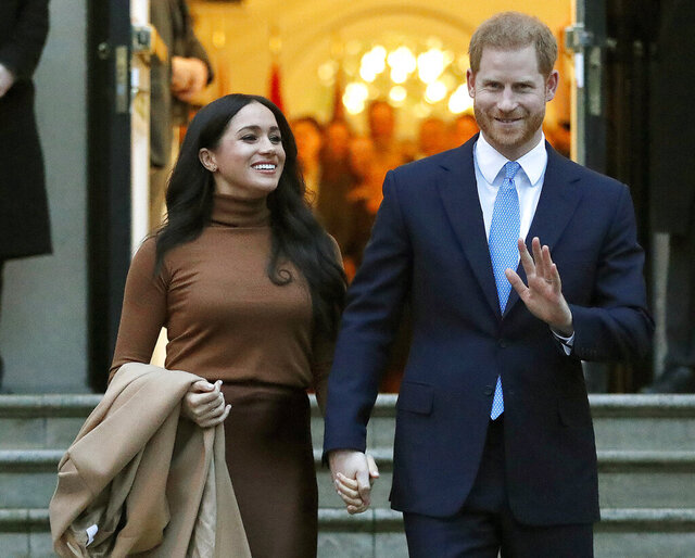 """FILE - In this Tuesday, Jan. 7, 2020 file photo, Britain's Prince Harry and Meghan, Duchess of Sussex leave after visiting Canada House in London. The Duke and Duchess of Sussex say they will no longer cooperate with several British tabloid newspapers because of what they call """"distorted, false or invasive"""" stories. Meghan and Harry have written to the editors of The Sun, the Daily Mail, the Daily Express and the Daily Mirror saying they won't """"offer themselves up as currency for an economy of click bait and distortion."""" They say stories based on """"salacious gossip"""" have upended the lives of acquaintances and strangers alike. (AP Photo/Frank Augstein, File)"""