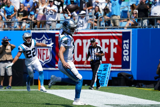Carolina Panthers quarterback Sam Darnold celebrates after scoring against the New York Jets during the first half of an NFL football game Sunday, Sept. 12, 2021, in Charlotte, N.C. (AP Photo/Jacob Kupferman)