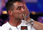Hossein Ensan, of Germany, kisses the bracelet after winning the World Series of Poker main event, Wednesday, July 17, 2019, in Las Vegas. (AP Photo/John Locher)