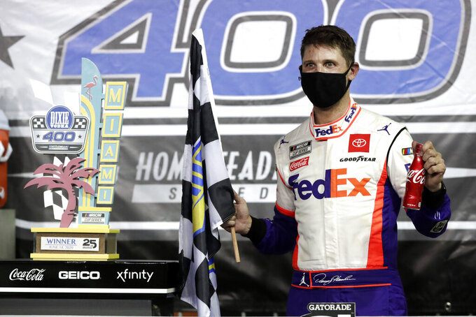 Denny Hamlin celebrates after winning a NASCAR Cup Series auto race Sunday, June 14, 2020, in Homestead, Fla. (AP Photo/Wilfredo Lee)