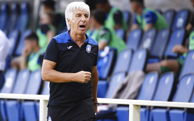 Atalanta coach Gian Piero Gasperini leaves the field after receiving the red card during the Italian Serie A soccer match between Atalanta and Bologna, at the Gewiss Stadium in Bergamo, Italy, Tuesday, July 21, 2020. (Giuseppe Zanardelli/LaPresse via AP)