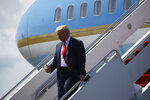 President Donald Trump steps off Air Force One at Tampa International Airport in Tampa, Fla., Friday, July 31, 2020. (AP Photo/Patrick Semansky)