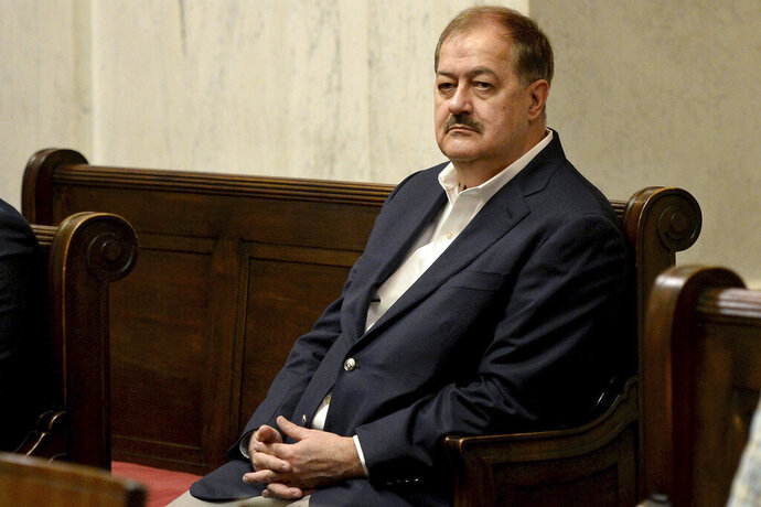 In this Aug. 29, 2018, file photo, Don Blankenship listens to arguments in the West Virginia Supreme Court n Charleston, W.Va. On Wednesday, Jan. 15, 2020, a federal judge in West Virginia refused to toss the misdemeanor conviction of former coal CEO Don Blankenship for conspiring to violate mine safety laws. (Chris Dorst/Charleston Gazette-Mail via AP, File)