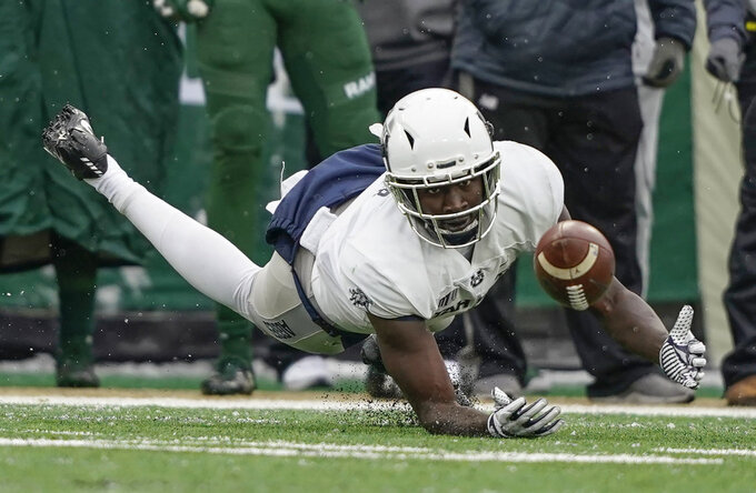 Utah State wide receiver Ron'quavion Tarver (1) attempts to catch a pass against Colorado State during the first half of an NCAA football game Saturday, Nov. 17, 2018, in Fort Collins, Colo. (AP Photo/Jack Dempsey)