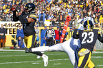 File-Pittsburgh Steelers free safety Minkah Fitzpatrick, left, makes an interception of a pass intended for Indianapolis Colts tight end Jack Doyle (84) in the first half of an NFL football game, in Pittsburgh, Sunday, Nov. 3, 2019. Fitzpatrick ran it back for a touchdown. Fitzpatrick's arrival in Pittsburgh last fall turned a pretty good defense into one of the NFL's best. His goal for an encore after earning All-Pro status? Helping Pittsburgh return to the playoffs. (AP Photo/Gene J. Puskar, File)