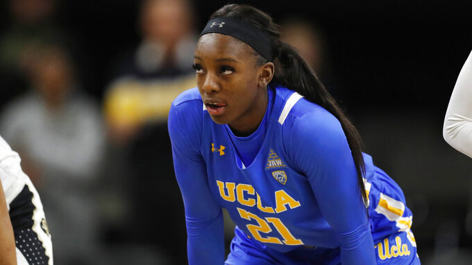 FILE - In this Jan. 12, 2020, file photo, UCLA forward Michaela Onyenwere (21) watches during the first half of an NCAA college basketball game in Boulder, Colo. (AP Photo/David Zalubowski, File)