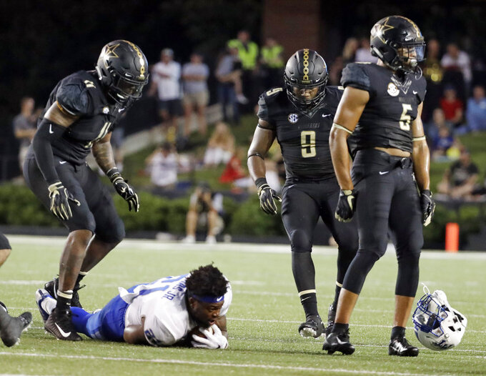 In this Sept. 1, 2018, photo, Vanderbilt safety LaDarius Wiley (5) walks away after bringing down Middle Tennessee running back Tavares Thomas (21) and knocking his helmet off in the first half of an NCAA college football game in Nashville, Tenn. Wiley was ejected for targeting Thomas on the play, but should return against Nevada Saturday. Vanderbilt smothered a mobile quarterback in their season opener against Middle Tennessee and will face another potent offense in Nevada. (AP Photo/Mark Humphrey)
