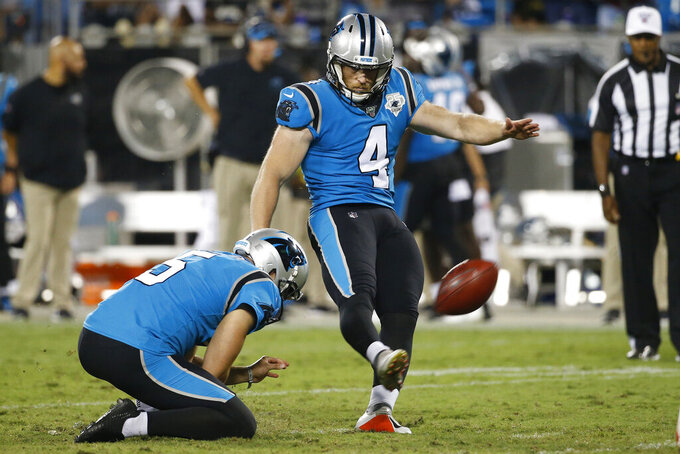 Carolina Panthers kicker Joey Slye (4) kicks a field goal during the first half of an NFL football game against the Tampa Bay Buccaneers in Charlotte, N.C., Thursday, Sept. 12, 2019. (AP Photo/Brian Blanco)