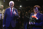 Presidential candidate Jiri Drahos accompanied by his wife Eva addresses media after announcement of the preliminary results of the presidential elections in Prague, Czech Republic, Saturday, Jan. 13, 2018. Czech President Milos Zeman failed to win re-election during the first round of voting on Saturday and will face a runoff election in two weeks against the former head of the country's Academy of Sciences Jiri Drahos. (AP Photo/Petr David Josek)