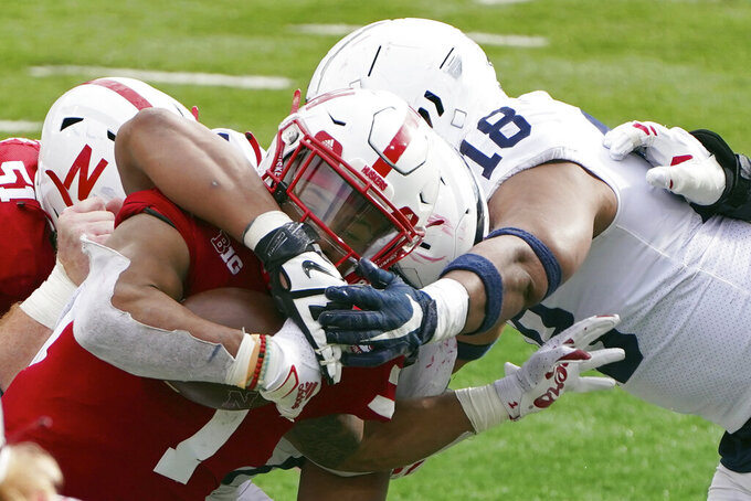 Nebraska wide receiver Wan'Dale Robinson (1) is tackled by Penn State defensive end Shaka Toney (18) during the second half of an NCAA college football game in Lincoln, Neb., Saturday, Nov. 14, 2020. Nebraska won 30-23. (AP Photo/Nati Harnik)