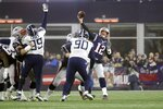 New England Patriots quarterback Tom Brady, right, passes under pressure from Tennessee Titans defensive ends Jurrell Casey (99) and DaQuan Jones (90) in the second half of an NFL wild-card playoff football game, Saturday, Jan. 4, 2020, in Foxborough, Mass. (AP Photo/Steven Senne)