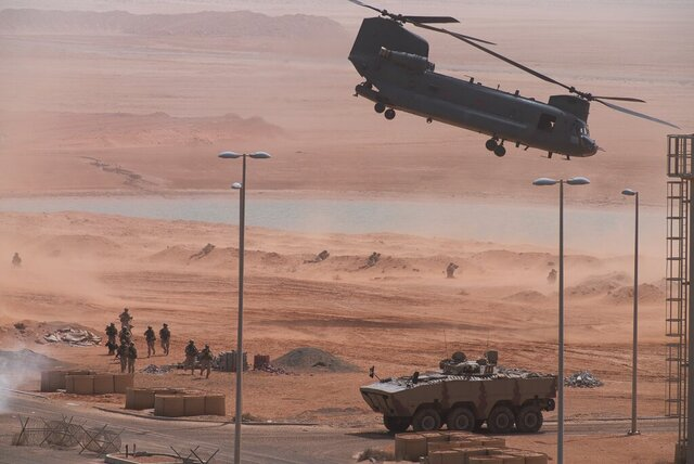 An Emirati Boeing CH-47 Chinook takes off during an exercise at an Emirati military base home to a Military Operations in Urban Terrain facility in al-Hamra, United Arab Emirates, Monday, March 23, 2020. The U.S. military held the major exercise Monday with Emirati troops in the UAE's far western desert at a facility designed to look like a Mideast city amid ongoing tensions with Iran. (AP Photo/Jon Gambrell)