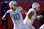 Los Angeles Chargers quarterback Justin Herbert (10) looks to pass during the first half of an NFL football game against the Denver Broncos, Sunday, Nov. 1, 2020, in Denver. (AP Photo/David Zalubowski)