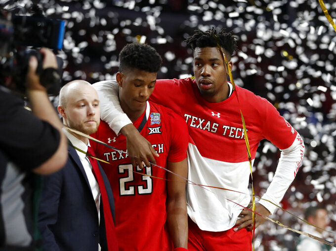 Texas Tech's Jarrett Culver (23) and Brandone Francis react after the team's 85-77 loss to Virginia in the overtime in the championship of the Final Four NCAA college basketball tournament, Monday, April 8, 2019, in Minneapolis. (AP Photo/Jeff Roberson)