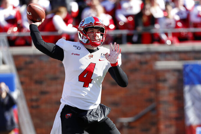 Western Kentucky quarterback Ty Storey throws the ball during the first half of the NCAA First Responder Bowl college football game against Western Michigan in Dallas, Monday, Dec. 30, 2019. (AP Photo/Roger Steinman)