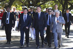 In this photo released by Brazil's Presidential Press Office, Brazil's President Jair Bolsonaro, second right, and Justice Minister Sergio Moro, second left, attend a military ceremony in Brasilia, Brazil, Tuesday, June 11, 2019. Moro has met with President Jair Bolsonaro, two days after press reports accused him of allegedly coordinating with prosecutors when he was a judge. (Marcos Correa/Brazil's Presidential Press Office via AP)