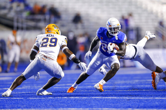 Boise State running back Taequan Tyler (25) cuts away from UTEP linebacker James Neal (29) during the second half of an NCAA college football game Friday, Sept. 10, 2021, in Boise, Idaho. (AP Photo/Steve Conner)