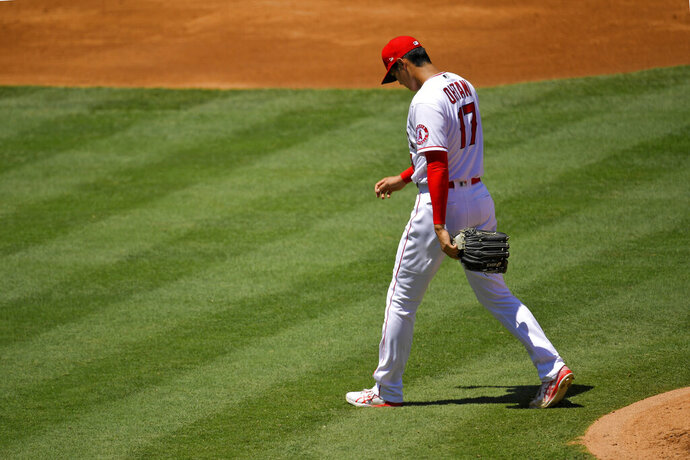 Los Angeles Angels pitcher Shohei Ohtani, of Japan, walks off the mound after being taken out of the baseball game during the second inning against the Houston Astros on Sunday, Aug. 2, 2020, in Anaheim, Calif. (AP Photo/Mark J. Terrill)