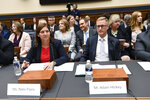 Deputy Assistant Director for Counterterrorism at the FBI Nikki Flores, left, and Deputy Assistant Attorney General for National Security Adam Hickey, right, wait to testify before the House Judiciary Committee hearing on Capitol Hill in Washington, Tuesday, Oct. 22, 2019, on election security. (AP Photo/Susan Walsh)