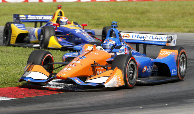 Scott Dixon races his car ahead of Alexander Rossi during the IndyCar Series auto race, Sunday, July 28, 2019, at Mid-Ohio Sports Car Course in Lexington, OH. (AP Photo/Tom E. Puskar)