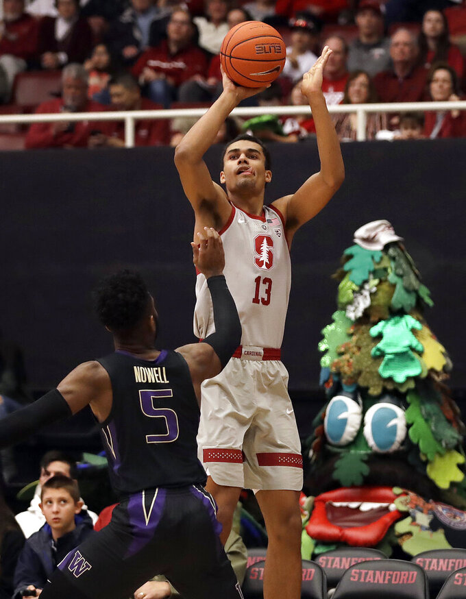 Stanford's Oscar Da Silva (13) shoots over Washington's Jaylen Nowell (5) in the first half of an NCAA college basketball game Sunday, March 3, 2019, in Stanford, Calif. (AP Photo/Ben Margot)