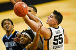 Iowa center Luka Garza (55) fights for a rebound with Southern University guard Ahsante Shivers during the second half of an NCAA college basketball game, Friday, Nov. 27, 2020, in Iowa City, Iowa. Iowa won 103-76. (AP Photo/Charlie Neibergall)
