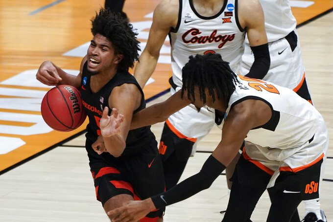 Oregon State guard Ethan Thompson (5) is fouled by Oklahoma State guard Keylan Boone (20) during the second half of a men's college basketball game in the second round of the NCAA tournament at Hinkle Fieldhouse in Indianapolis, Monday, March 22, 2021. (AP Photo/Paul Sancya)