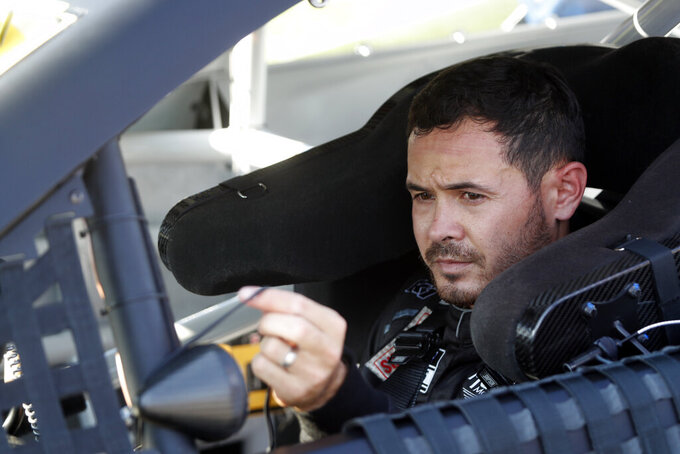 NASCAR Cup Series driver Kyle Larson (5) prepares for a NASCAR Cup Series auto race at the Las Vegas Motor Speedway Sunday, Sept. 26, 2021, in Las Vegas. (AP Photo/Steve Marcus)