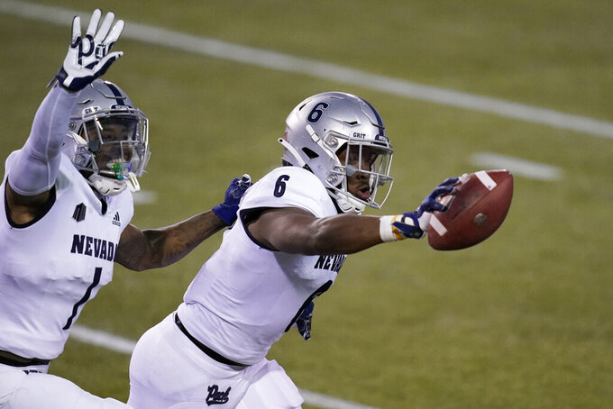 Nevada defensive back Tyson Williams (6) celebrates after making an interception against New Mexico during the first half of an NCAA college football game Saturday, Nov. 14, 2020, in Las Vegas. (AP Photo/John Locher)