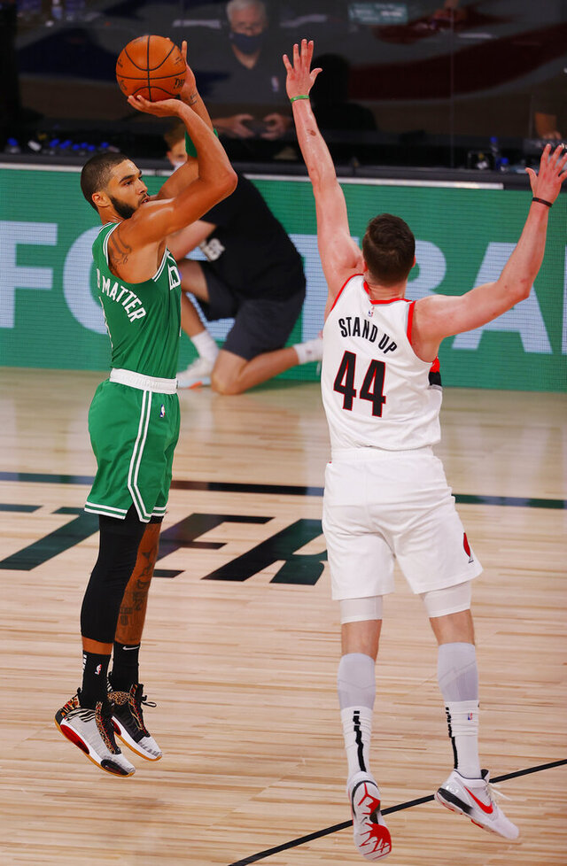 Boston Celtics' Jayson Tatum (0) shoots against Portland Trail Blazers' Mario Hezonja (44) during an NBA basketball game Sunday, Aug. 2, 2020, in Lake Buena Vista, Fla. (Mike Ehrmann/Pool Photo via AP)