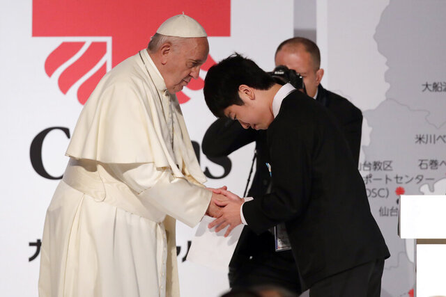 Pope Francis shakes hands with Matsuki Kamoshita as he meets with victims of the March 11, 2011 Fukushima nuclear plant disaster in northern Japan Monday, Nov. 25, 2019, in Tokyo, Japan. (AP Photo/Jae Hong)