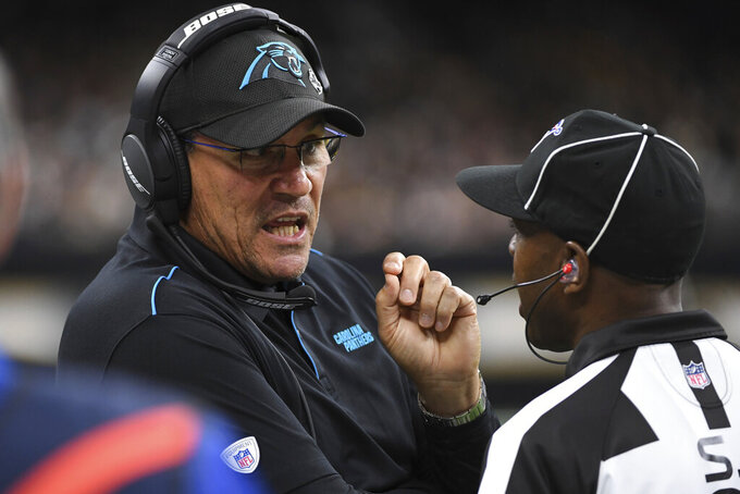 Carolina Panthers head coach Ron Rivera challenges a call with NFL side judge, Dale Shaw (104), during the first half at an NFL football game, Sunday, Nov. 24, 2019, in New Orleans. (AP Photo/Bill Feig)
