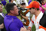 Clemson head coach Dabo Swinney, right, meets LSU head coach Ed Orgeron on the field after a NCAA College Football Playoff national championship game Monday, Jan. 13, 2020, in New Orleans. LSU won 42-25.(AP Photo/David J. Phillip)