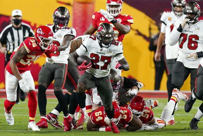 Tampa Bay Buccaneers running back Ronald Jones runs against the Kansas City Chiefs during the first half of the NFL Super Bowl 55 football game Sunday, Feb. 7, 2021, in Tampa, Fla. (AP Photo/Mark Humphrey)