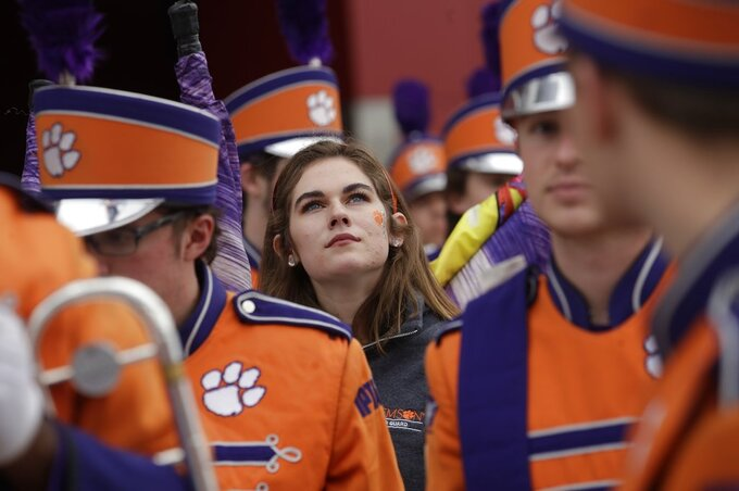 The Clemson band arrives for the NCAA college football playoff championship game against Alabama Monday, Jan. 7, 2019, in Santa Clara, Calif. (AP Photo/Jeff Chiu)