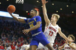 South Dakota State forward Douglas Wilson (35) drives past Arizona forward Stone Gettings in the first half during an NCAA college basketball game, Thursday, Nov. 21, 2019, in Tucson, Ariz. (AP Photo/Rick Scuteri)
