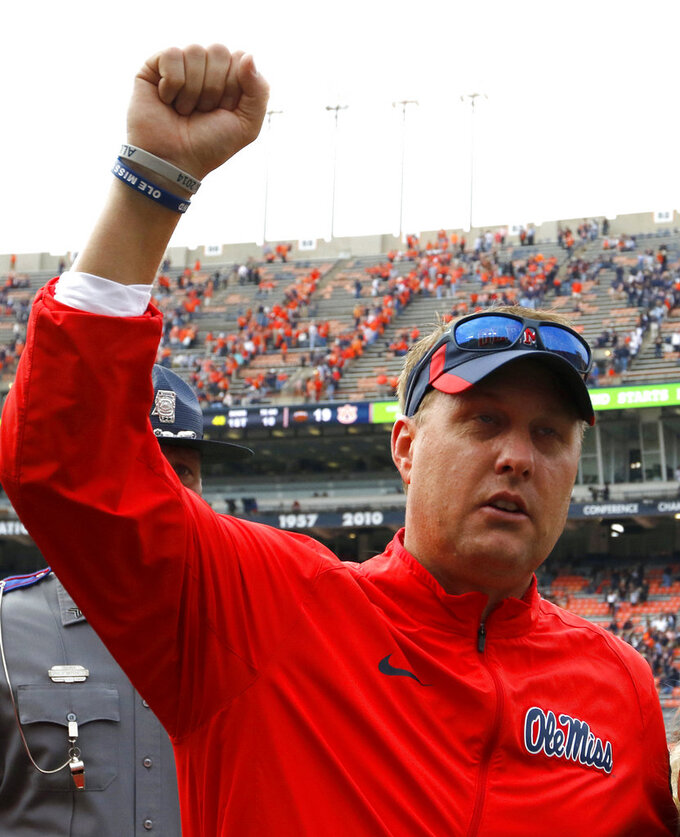 "FILE - In this Oct. 31, 2015, file photo, Mississippi head coach Hugh Freeze celebrates after defeating Auburn 27-19 after an NCAA college football game,  in Auburn, Ala. Liberty has hired former Mississippi coach Hugh Freeze to lead its football program. A person familiar with the situation told The Associated Press that the Flames have tabbed Freeze as their next coach. The person spoke to the AP on the condition of anonymity because neither the school nor Freeze has publicly announced the decision. Liberty has scheduled a news conference to ""name Liberty's next head football coach"" for Friday afternoon, Dec. 7, 2018.(AP Photo/Butch Dill)"